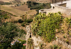 View down the steep rockface to valley in Ronda royalty free stock photos