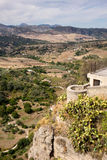 View down the steep rockface to valley in Ronda royalty free stock images
