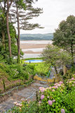 View down to the sea from Portmeirion. Stairs down to a pool by the coast Royalty Free Stock Photos