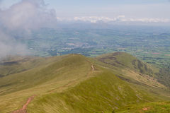 The view down along the path leading up to the summit of Pen y Fan in the Brecon Beacons National Park. The view down the valley along the trail. This route Stock Photos