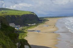 A view of Downhill Beach from the cliff top at Mussenden Temple in the Downhill Demesne in County Londonderry in Northern Ireland. The sandy beach stretches Royalty Free Stock Photos