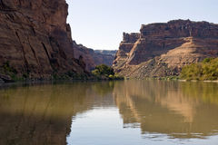 View Downriver. A downstream view of a river in a desert canyon Stock Photos
