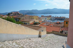 View downstairs to the port of old Portoferraio city with the fort Stella on the hill, Elba island. royalty free stock photos