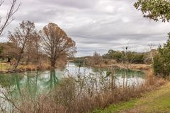 Blanco State Park 2. A view downstream along the Blanco River as it meanders through Blanco State Park Blanco, Texas. The clear river has a green color to it as stock photography