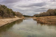 Blanco River 1. A view downstream along the Blanco River as it meanders west of Blanco, Texas. The clear river has a green color to it as it flows alongside a stock photos
