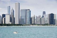 View on Downtown of Chicago with line of skyscrapers. View from the lake side on the downtown Chicago. On the low left side of the image is a small boat with Royalty Free Stock Images
