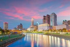 View of downtown Cleveland skyline in Ohio USA. At sunset stock photos