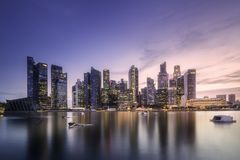 Downtown district and Marina bay in Singapore. View of downtown district and Marina bay skyline with purple sunrise in Singapore Stock Photo