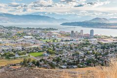 View of downtown Kelowna from Knox Mountain in autumn. Downtown Kelowna in autumn viewed from Knox Mountain with Okanagan Lake and William R. Bennett bridge in Royalty Free Stock Image