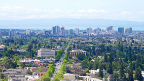 View of Downtown Oakland with Berkeley in the foreground. View from above University of California Berkeley on an overcast hazy Northern California day Royalty Free Stock Image