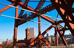 View of downtown Portland through metal truss of bridge Royalty Free Stock Photo