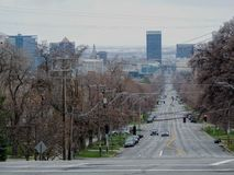 View of downtown Salt Lake City looking down 100 South from the University of Utah West towards the City in early spring March of royalty free stock image
