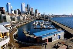 View of Downtown Seattle's Waterfront. A view of downtown Seattle's waterfront with ferris wheel and boats Royalty Free Stock Image