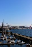View of Downtown Seattle's Waterfront. A view of downtown Seattle's waterfront with ferris wheel and boats Stock Photography