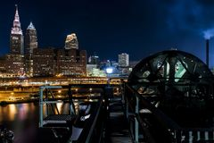 Dramatic Downtown Skyline at Sunset - Abandoned Cuyahoga River Lift Bridge in Cleveland, Ohio stock photos