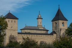 View of Dragomirna monastery behind trees. In Bukovina, (Bucovina), Moldavia (Moldova Stock Images