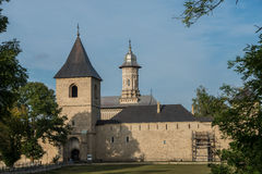 View of Dragomirna monastery behind trees. In Bukovina, (Bucovina), Moldavia (Moldova Royalty Free Stock Photos