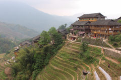 View with Dragon Ridge Terrace of rice fields and wood house Stock Photography