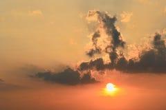 Dramatic rays and orange sky at sunset Royalty Free Stock Image
