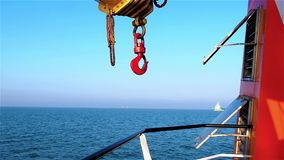 View of dredger vessel from tugs deck on clear day stock video footage