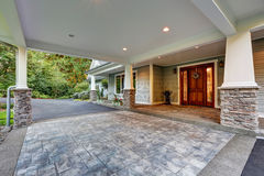 View of driveway with an all weather covered entry Stock Images