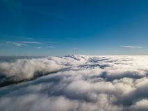 View of a drone above the fog, wind turbines with fog and blue sky. Aerial colors top shapes landscape portugal places nature natural mountain abstract royalty free stock photo