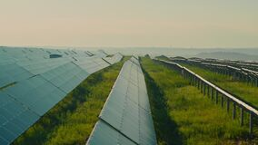 View from drone of hundreds solar panels on field
