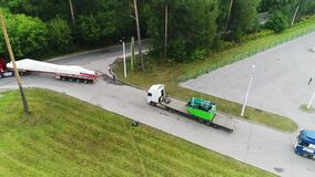 The view from the drone, the movement of the column, rotation, shipping, road, highway, the rotation of the camera