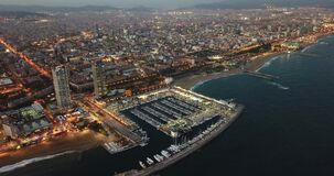 View from drones of coast in Barcelona and center with building
