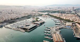View from drones of sailboats and yachts in old port of Barcelona