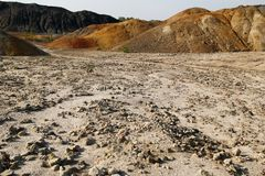 Dry polluted stony soil and hills in abandoned clay quarry. Stock Image