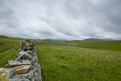View over a drystone wall in northern scotland Royalty Free Stock Photo