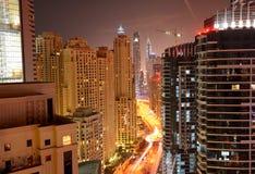 The view on Dubai city from skyscraper in night illumination Stock Image