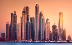 View of Dubai Marina bay during sunset, UAE. Modern buildings with gold reflection of sunset on Dubai Marina bay, UAE Stock Photos