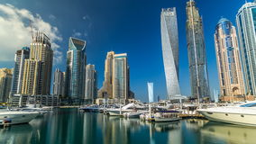 View of Dubai Marina tallest Towers in Duba timelapse hyperlapse. Beautiful view from Promenade on Dubai Marina tallest modern Towers and floating yachts and stock footage