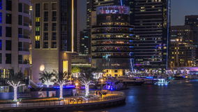 View of Dubai Marina Towers and canal in Dubai day to night timelapse stock video footage
