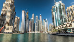 View of Dubai Marina Towers in Dubai at day time timelapse hyperlapse. Beautiful day view on Dubai Marina modern tall Towers reflected in water from Promenade stock video footage
