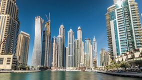 View of Dubai Marina Towers in Dubai at day time timelapse hyperlapse. Beautiful day view on Dubai Marina modern tall Towers reflected in water from Promenade stock footage