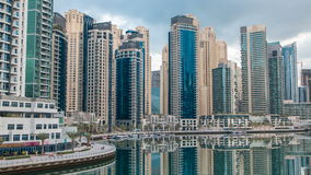 View of Dubai Marina Towers in Dubai at morning time timelapse. Beautiful morning view from bridge on Dubai Marina modern Towers reflected in water and promenade stock footage