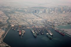 View of Dubai Port. Shot during take off on my way to Dammam from Dubai. Fantastic view of Dubai Port and docked ships and tankers Royalty Free Stock Photos