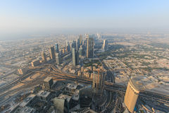 View of Dubai at sunset from the Burj Khalifa. Royalty Free Stock Images