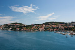 View on Dubrovnik. An amazing view from above on Dubrovnik with houses with tegular red roofs and green hills, Croatia Royalty Free Stock Images