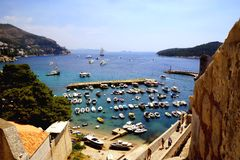 The view of Dubrovnik bay, Croatia. It is nice to use the opportunity too enjoy gorgeous view of the sea bay and old city of Dubrovnik including part of the city royalty free stock photos