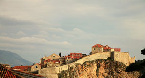 View on Dubrovnik , Croatia. Magic moment after storm, sunlight and dark clouds above famous city Dubrovnik , Croatia. Typical architecture, stone houses Royalty Free Stock Image