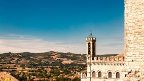 View of the ducal palace. Gubbio Italy: View of the ducal palace and view of the Italian countryside Royalty Free Stock Photo