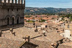 View of the ducal palace. Gubbio Italy: View of the ducal palace and view of the splendid Italian roofs Stock Photos