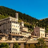 View of the ducal palace. Italy: view of the ducal palace of Gubbio. In the background the wooded forest of Mount Ingino royalty free stock photo