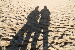 Uman shadows on the Dune du Pilat near Bordeaux in France Royalty Free Stock Photography