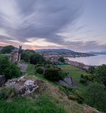 View of Dunoon from the castle ruins. View of Dunoon from the castle ruins at sunset Royalty Free Stock Image