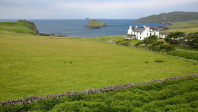 View of Duntulm Bay in the northern part of the Trotternish peninsula with the ruins of Duntulm Castle on the left side and Tulm I Stock Photography